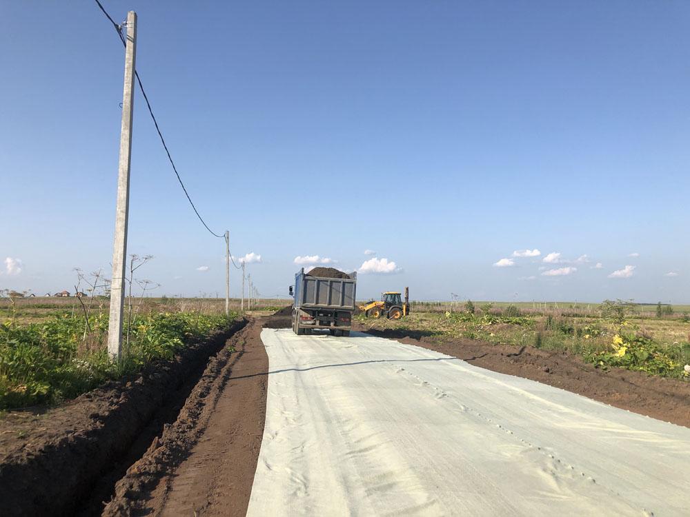 Строительство дороги на улице Березовой